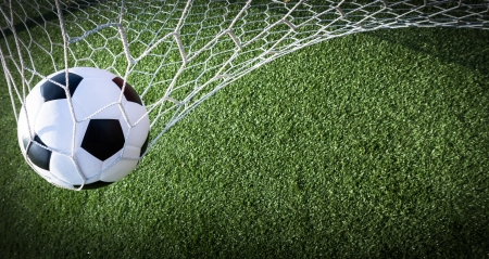 soccer ball on grass: Soccer ball in goal, success concept Stock Photo