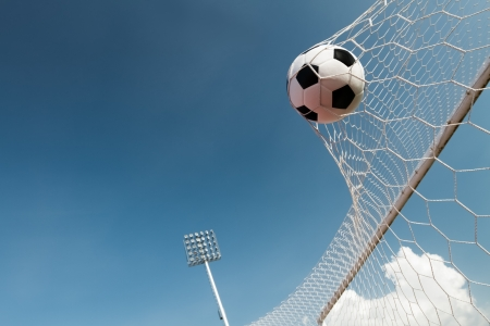 Soccer ball in goal, success concept Foto de archivo