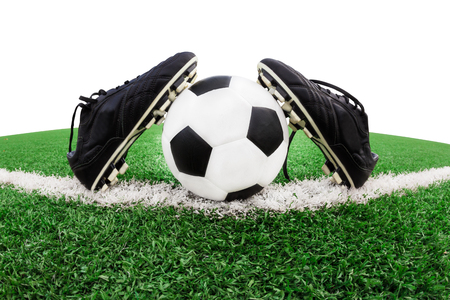 football shoes: Isolated shoes and soccer ball on green grass Stock Photo