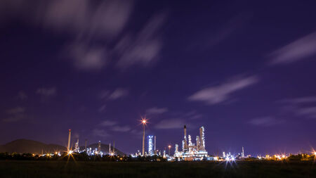 scenic of petrochemical oil refinery plant shines at night photo