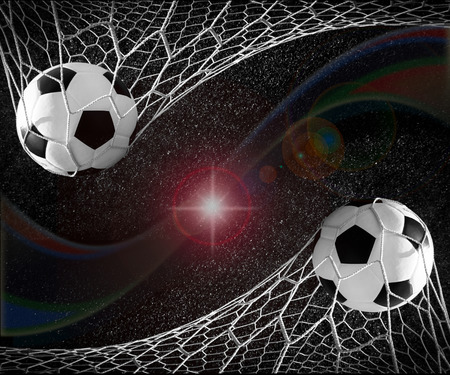 Soccer ball in goal, success concept Stock Photo