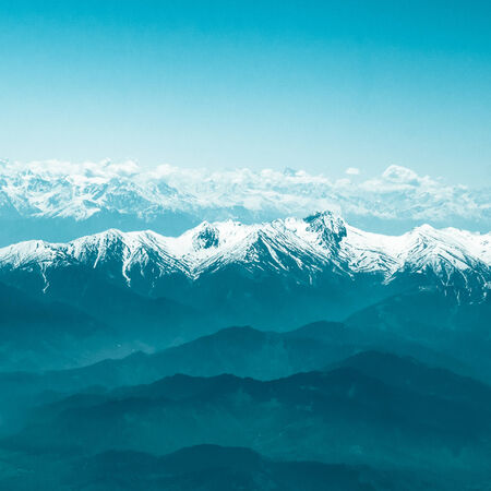 Snow Mountain Range Landscape with Blue Sky photo