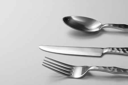 silver reflection: Cutlery set with Fork, Knife and Spoon Stock Photo