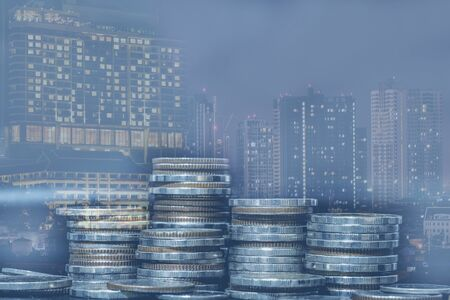 Financial investment concept, Double exposure of city night and stack of coins for finance investor, Forex trading candlestick chart economic , ECN Digital economy, business, money, passive income. Stockfoto