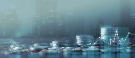 Financial investment concept, Double exposure of city night and stack of coins for finance investor, Forex trading candlestick chart economic, ECN Digital economy, business, money, passive income. Stockfoto