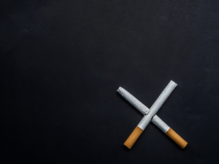 World No Tobacco Day, Broken cigarette isolated on black background. No smoking concept. Stock Photo - 101863678