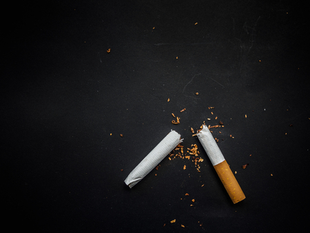 World No Tobacco Day, Broken cigarette isolated on black background. No smoking concept.