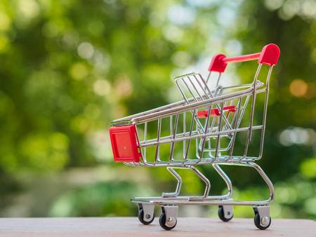 Shopping trolley on bokeh background. Shopping concept.