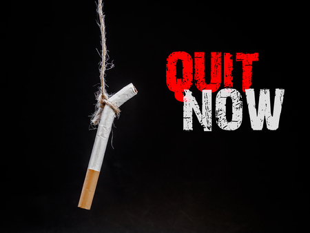 hanging cigarete on black background. kill yourself.  Quitting smoking concept. world no tobacco day Фото со стока