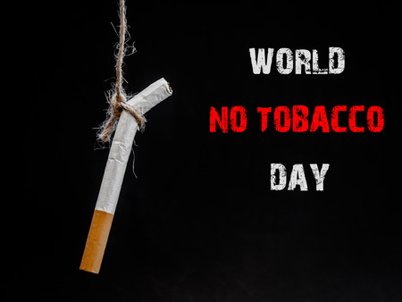 hanging cigarete on black background. kill yourself.  Quitting smoking concept. world no tobacco day Stock Photo