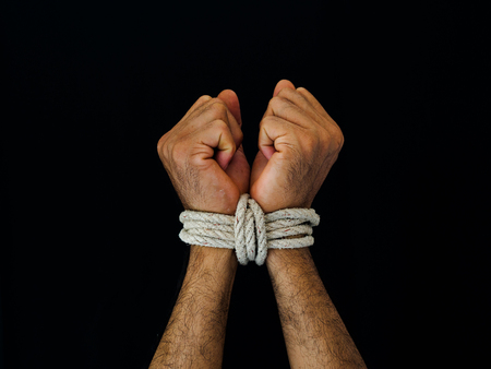 Man hands were tied with a rope. Violence, Terrified, Human Rights Day concept. Stock Photo