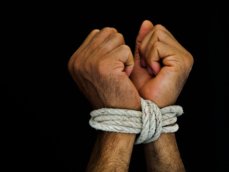 Man hands were tied with a rope. Violence, Terrified, Human Rights Day concept. Stok Fotoğraf