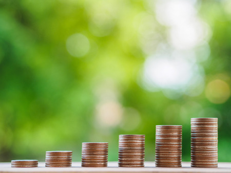 Saving money concept.  growing business concept. money coin stack on the table on bokeh background. 写真素材