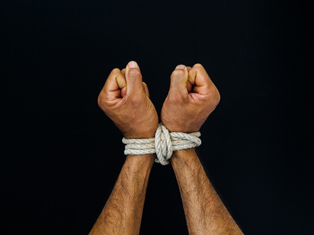 Man hands were tied with a rope. Violence, Terrified, Human Rights Day concept. Archivio Fotografico