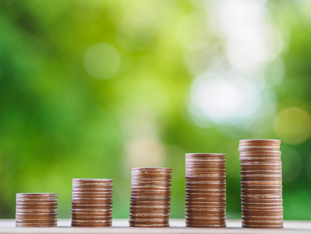 Saving money concept.  growing business concept. money coin stack on the table on bokeh background. Stock Photo