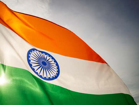 The wavy Indian flag on the sunset sky. Indian independence day. Stock Photo