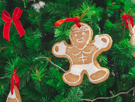 Closeup Soft focus gingerbread decorate on christmas tree. ChristmasDay Background. Stock Photo