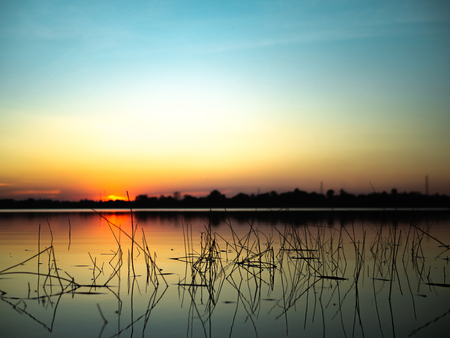 Sunset on the lake background. 版權商用圖片