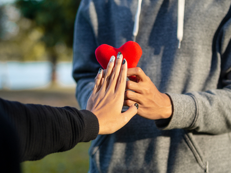 Woman refusing red heart form the man. Broken heart, Love, Valentine'sDay Concept. 版權商用圖片