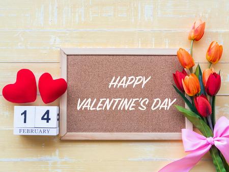 Valentine's Day Background. Red Heart, 14 February wooden calendar, Flower on Wooden background.