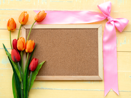 Valentine's Day Background. Pink Ribbon and Flower on Wooden background. 版權商用圖片