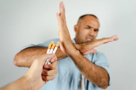 Man refusing a cigarettes.