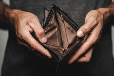 Close up of man hands holding and empty wallet. financial crisis, bankruptcy, no money, bad economy Concept.