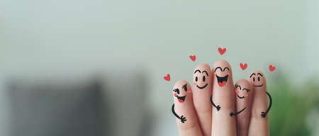 Closeup of Fingers With Happy Smiling Face, Friendship, Family, Group, Teamwork, Comunity, Unity, Love Concept.