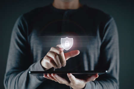 Young man hand touching on virtual Screen Padlock Icon. data protection, information privacy, Cybersecurity, Unlock, internet networking technology concept. 免版税图像