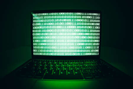 Closeup of the laptop computer with Binary Code screen, virus or malware for hacking internet server, Cyber attack, System breaking, Internet crime concept.