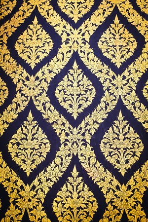 traditional Thai style art gold painting pattern on the door photo