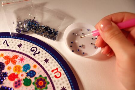 lesson diamond mosaic. set for gluing rhinestones on a butterfly picture. A lesson for the development of fine motor skills for children and adults. horizontal photo. the details