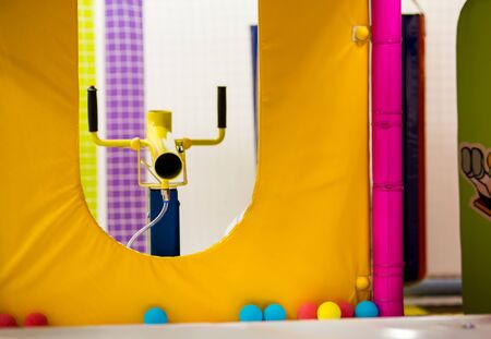 yellow shotgun for foam balls. activities for children in the playground in the room.