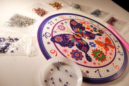 lesson diamond mosaic. set for gluing rhinestones on a butterfly picture. A lesson for the development of fine motor skills for children and adults. horizontal photo. the details.