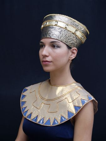 headgear: Young lady in Egyptian clothes on a black background