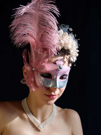 modest: Young modest lady in fancy mask with pearl necklace