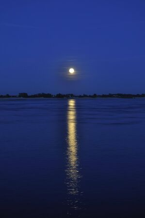 river scape: Full moon river landscape with tiny clouds and lunar Stock Photo