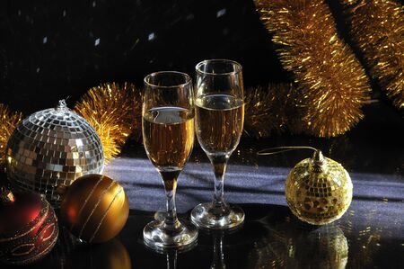 New Year decoration background with wine glasses on black Stock Photo