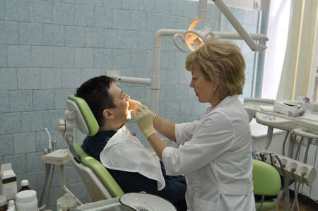 Medical treatment at the dentist office photo