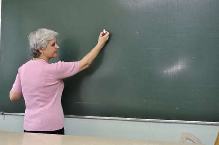 School teacher lady at the lesson in the classroom Banque d'images