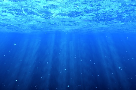 under the surface: Blue underwater background with bubbles Stock Photo