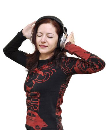 Beautiful brunette lady with the headphones listening to music with eyes closed photo