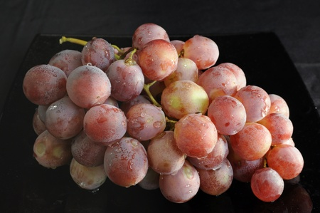 fascicle: Grape bunch on a black background Stock Photo