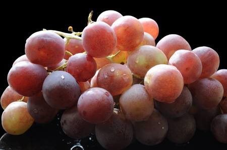 Grape raceme isolated on black background Stock Photo