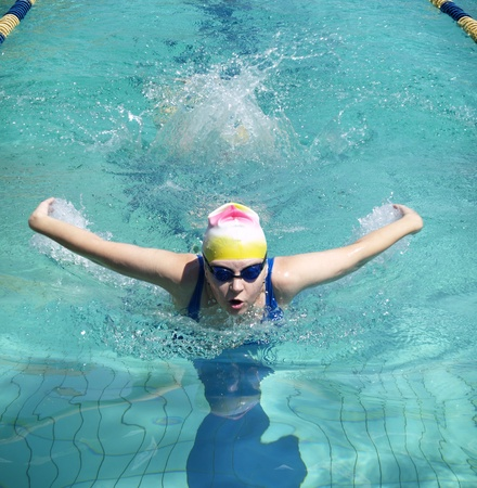 Swimming woman performing butterfly style