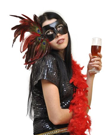 Lady in fancy mask with a glass of wine on white background photo