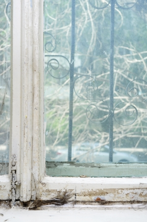 mouldy: Background of neglected window with layers of old paint