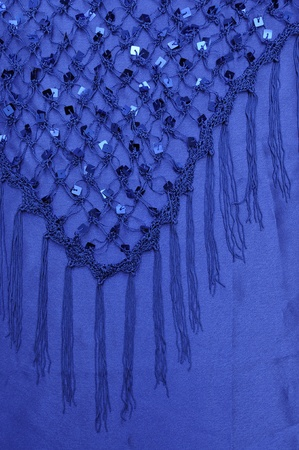 Net with Square Sequins above the cloth background photo