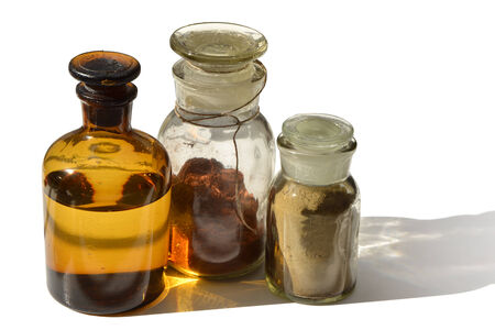 compounding: A set of chemical bottles with different content isolated on white Stock Photo