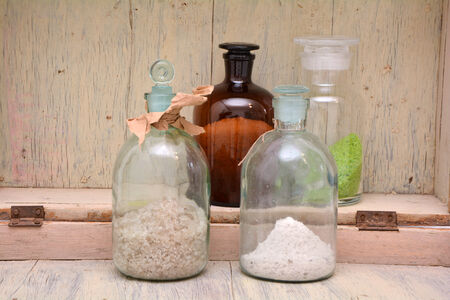 formulation: A set of chemical bottles with different content